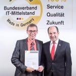 """ASPION Geschäftsführer Michael Wöhr nimmt die BITMI-Auszeichnung """"Software Made in Germany"""" entgegen."""